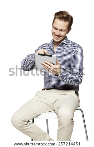 Portrait of happy man working on a tablet.  - stock photo