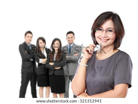 portrait of happy mature business women in front of her underlink - stock photo