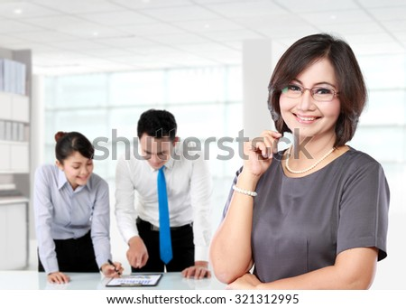 portrait of happy mature business women with her underlink behind - stock photo