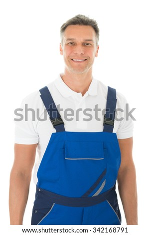Portrait of happy mature male janitor standing against white background - stock photo