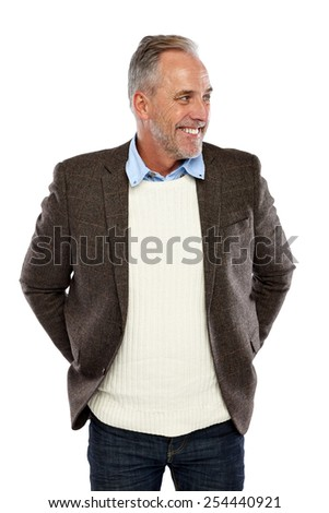 Portrait of happy mature man looking away at copyspace on white background - stock photo