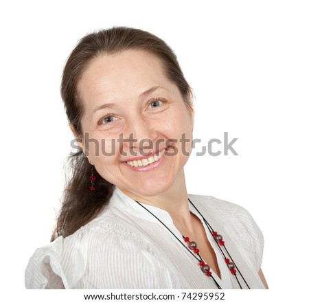 Portrait of happy mature woman smiling against white background