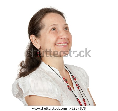Portrait of happy mature woman smiling against white background - stock photo