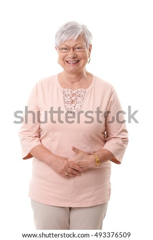 Portrait of happy mature woman smiling, looking at camera.