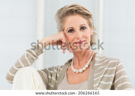 Portrait Of Happy Mature Woman Wearing Necklace - stock photo