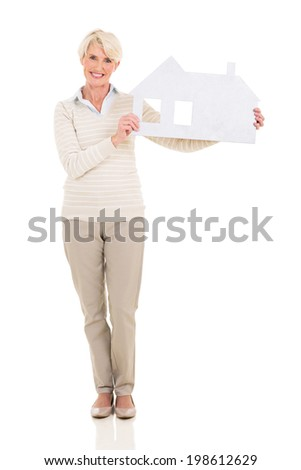 portrait of happy middle age woman holding paper house - stock photo