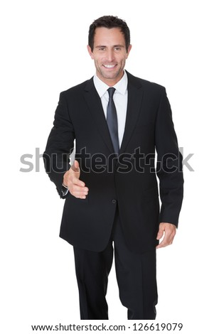 Portrait of happy middle aged businessman offering handshake. Isolated on white - stock photo