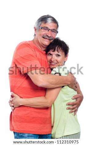 Portrait of happy middle aged couple in love, isolated on white background. - stock photo