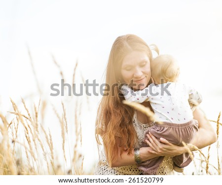 Portrait of happy mother and child outdoor  - stock photo
