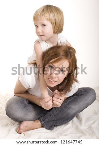 portrait of happy mother and daughter  hugging and smiling isolated