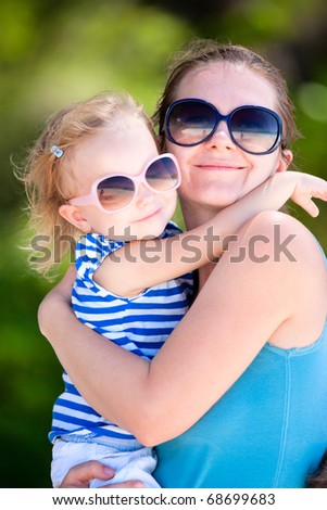 Portrait of happy mother and her adorable little daughter