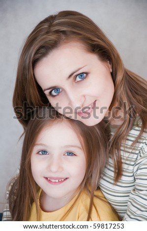 Portrait of happy mother and sweet daughter