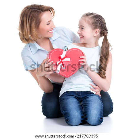 Portrait of happy mother and young daughter hold gift for birthday  - isolated - stock photo