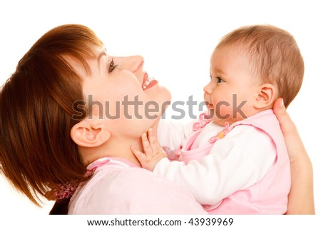 Portrait of happy mother holding baby girl