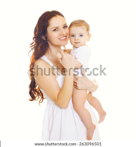 Portrait of happy mother holding on the hands baby  - stock photo