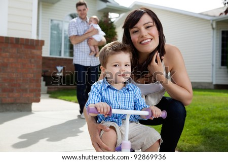 Portrait of happy mother sitting besides her son with in background - stock photo