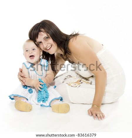 Portrait of happy mother sitting with her smiling baby