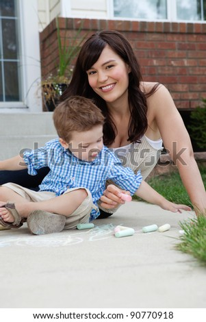 Portrait of happy mother spending quality time with her son - stock photo