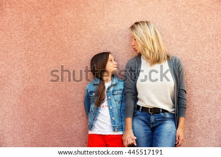 Portrait of happy mother with daughter - stock photo