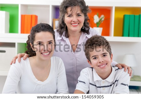 Portrait of happy mother with her son and daughter - stock photo