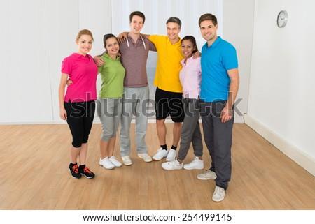 Portrait Of Happy Multiethnic People Standing In Gym - stock photo
