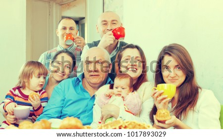 Portrait of happy multigeneration family having tea at home