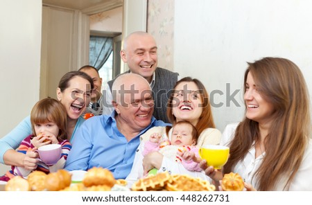 Portrait of happy multigeneration family with baby at home