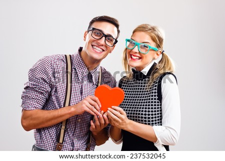 Portrait of happy nerdy couple,We are in love! - stock photo