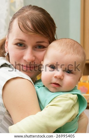 Portrait of happy newborn baby and mother - stock photo
