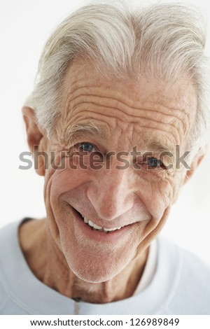 Portrait of happy old man isolated over white background - stock photo