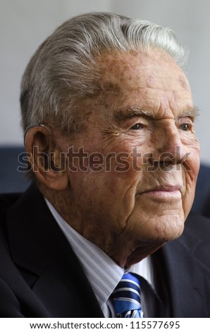 Portrait of happy old man wearing a suit in his 90's.  isolated on white background.Concept photo of senior citizen, retirement, pensioner, health and aging.