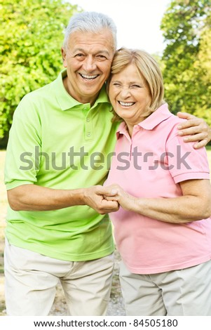 Portrait of happy old people looking at camera. - stock photo