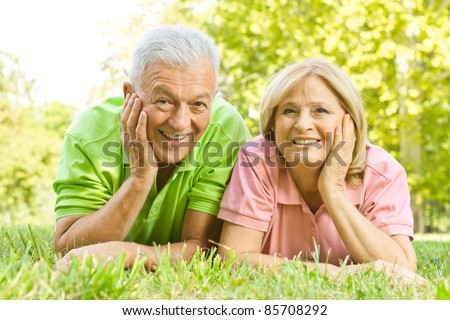 Portrait of happy old people relaxed in nature. - stock photo