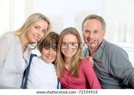 Portrait of happy parents and children - stock photo
