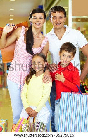 Portrait of happy parents and children during shopping - stock photo