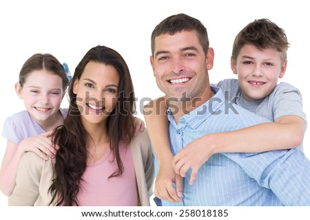 Portrait of happy parents giving piggyback ride to children against white background - stock photo