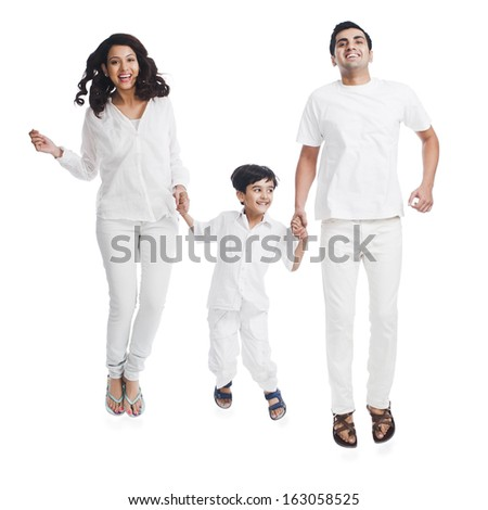 Portrait of happy parents with their son - stock photo