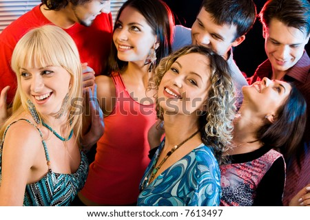 Portrait of happy people interacting at a evening-party - stock photo
