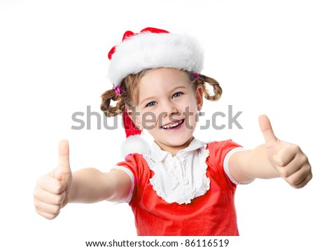 portrait of happy pretty little  girl  in red santa's hat with thumbs up looking at camera toothy smiling isolated on white - stock photo