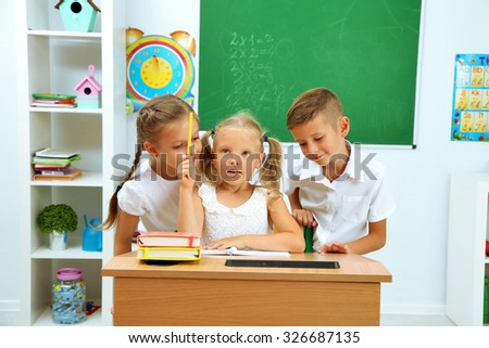 Portrait of happy pupils at lesson - stock photo