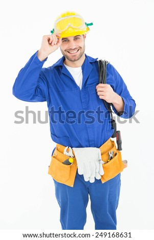 Portrait of happy repairman wearing yellow hardhat against white background - stock photo