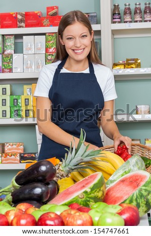 Portrait of happy saleswoman working at supermarket - stock photo
