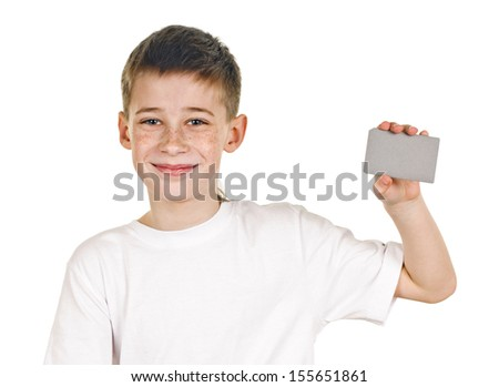 portrait of happy schoolboy with card on white background