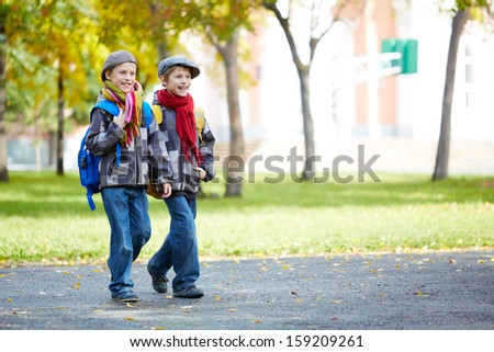 Portrait of happy schoolboys in casual going to school - stock photo