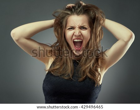 stock photo portrait of happy screaming woman 429496465