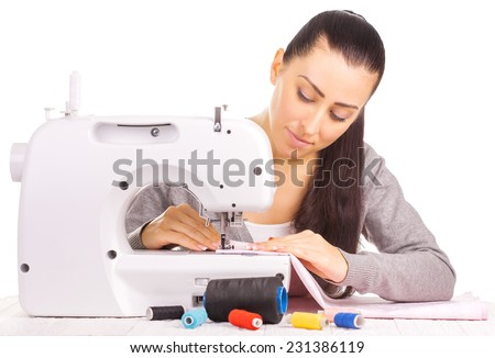 Portrait of happy seamstress sewing. isolated on the white - stock photo