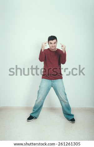 Portrait of happy self-confident man provoking. - stock photo