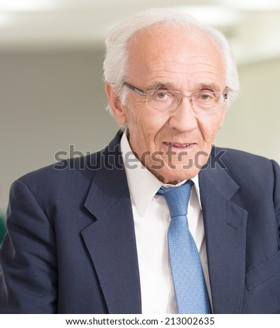 Portrait of happy senior business man - stock photo