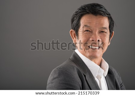 Portrait of happy senior businessman - stock photo
