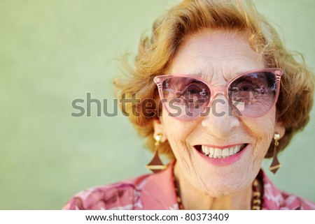 portrait of happy senior caucasian woman looking at camera and smiling. Horizontal shape, copy space - stock photo